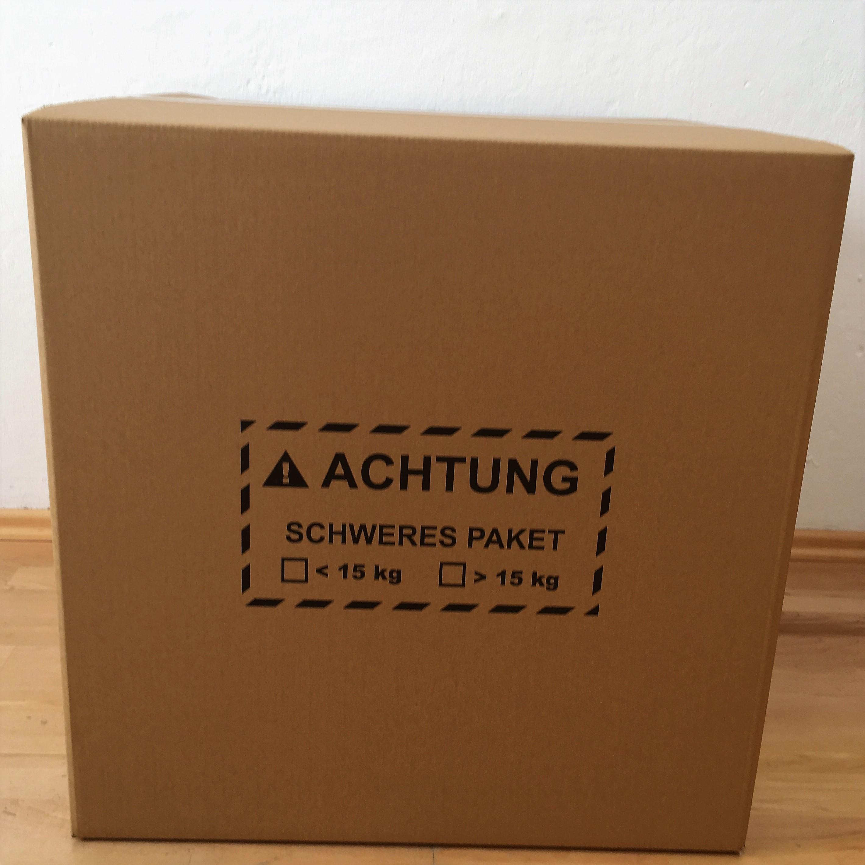 Amazon FBA-Karton mit Höhenrillern, Kennzeichnung Schweres Paket